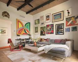 in the den a patched cowhide rug a vladimir kagan sofa covered in
