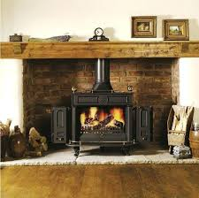image result for wood burning stove corner fireplace above electric tv stand canada