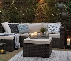 small garden with rattan effect sofa chairs and table