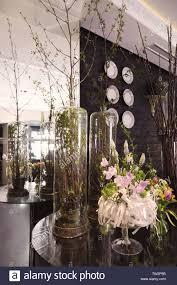 Modern Flower Shop Interior Design Plants On Round Glass Table In Beautiful Interior Of Modern