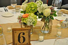 Decorating With Mason Jars And Burlap mason jar burlap wedding centerpieces with green flowers iPunya 58
