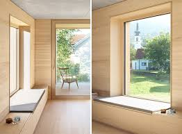 this window has a deep sill and upholstered cushion that extends out to join up with