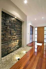 High Quality Magnetic Interior Walls Designed With Stones : Minimalist Front Room Design  With Wooden Floor Decoration And Interior Stone Wall