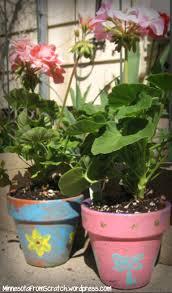 Painted flower pots with flowers - MinnesotaFromScratch.wordpress.com