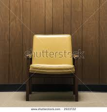 office wood paneling. Retro Chair Against Wood Paneling In Office. Office
