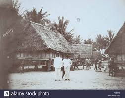 66 Peter Olsen and Harry O'Keefe in a village on the Mapia Islands ...