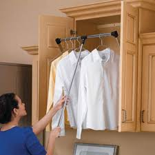 and use any empty space above regular reaching height with a pull down closet rod for all of your out of season or less used stuff