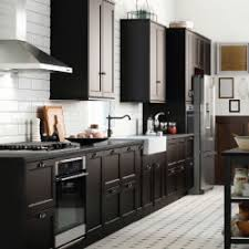 A Large Kitchen With Black Brown Drawers And Doors. Shown Together With  Stainless Steel ...