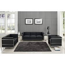 black leather sofa furniture set with black desk lamp also shag rug and paintings on the wall 615x615