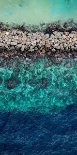 Blue green water, aerial view, rocks ...