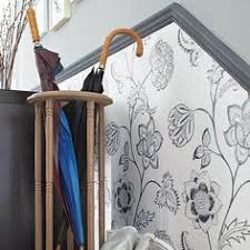 paper beneath a chair rail creates low cost wainscot embossed types hold up well