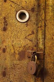 old rusty lock on a metal door close the barn from robbery and theft stock photo colourbox