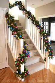 Christmas Staircase-lighted garland and ornaments. I want to do this but  above my