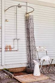 simple outdoor shower with curved shower curtain rod