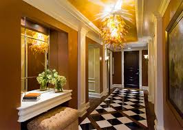 blown glass chandelier entry traditional with brown walls carved wood front door ceiling