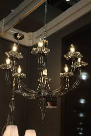 italian lighting company metal lux creates artful designs from glass this traditionally shaped glass chandelier