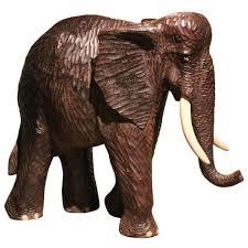 oversized carved wood elephant for