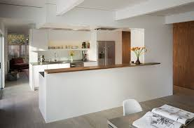 view in gallery connect the kitchen with the dining space with a half wall