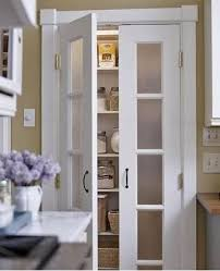 Frosted glass for linen closet doors. Dark chunky wood shelving ...