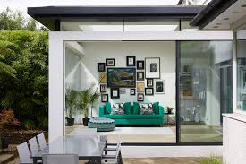 Garden room extension with a picture frame glass window, slimline ...