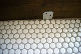 Remodelaholic tips for installing a penny tile backsplash diy penny tile  backsplash install doublecrazyfo Gallery