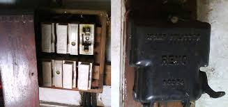 old electrical fuseboxes and switchgear double pole ceramic fusebox and cast iron splitter unit