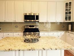 khaki glass tile kitchen backsplash with white cabinets granite
