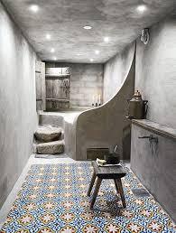 hammam style bathroom with tadelakt walls and beautiful moroccan tiles on the floor