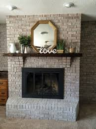 white washing brick with gray beige walking with dancers the family room s fireplace