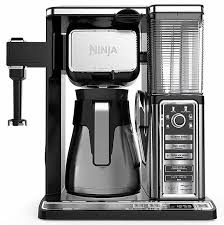 Open the brew basket by swinging it out of the coffee maker. The Best Combination Coffee And Espresso Machine A Definitive Guide