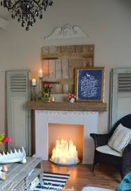 Homemade fireplace mantle with faux candles. Who needs a real fireplace?!  The Poor