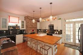 rustic tile kitchen countertops. Wonderful Kitchen Rustic Kitchen With Brick Fireplace And Black Tile Backsplash And Tile Kitchen Countertops