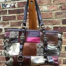 Not just for the Holidays, this gently used classic Coach Shoulder Bag made  with a patchwork of leather and suede can enhance your outfits all year  long.