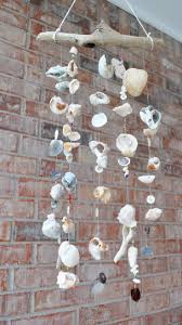 I spotted this sea shell wind chime earlier today. It reminds me of what I  used to do when I was a teenager. I used to collect a lot of sea shells ...