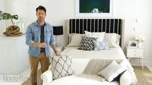 in addition to a graphic throw a neutral settee handmade ceramic pendants and a seaside photograph nate updated the bedroom with a handful of pillows