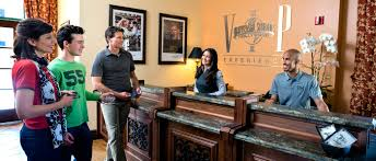 a family at the front desk of universal studios hollywood vip experience with two employees