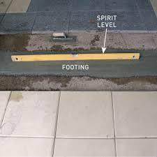 step 3 pour concrete footing handyman