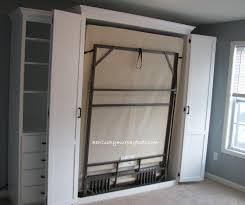 queen size bifold door murphy bed with side cabinet murphy desk and additional book case