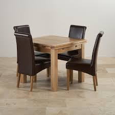 table 4 chairs. dorset solid oak dining set - 3ft extending table + 4 leather chairs e