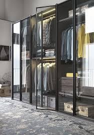 above from italian company lema the armadio al centimetro aria is a modular wardrobe system with glass doors