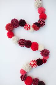 and i am beyond excited we have been out of town for the last 4 days so today is going to be spent decorating this pom pom garland