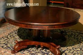 antique oak oval dining table. versatile 60 round dining table expands to 10 feet with leaves. beautifully carved pedestal base antique oak oval a