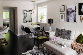 Small Living Dining Area with zebra hide, lucite ottoman, tulip table,  black and