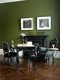 green wall paintoffice space of the dayblack tufted chairs  Apartment therapy