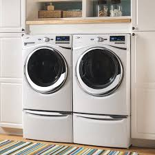 washing machine and dryer in a closet