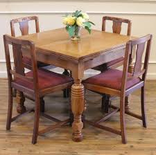 Antique English Oak Dining Table And Chairs