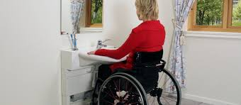 handicapped accessible bathroom sink counter. 2. a feature of some wheelchair accessible kitchens is the electronically adjustable counter. handicapped bathroom sink counter u