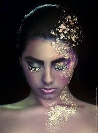 idea for shoot w liana marie golden child is a photographic beauty print of a covered in gold leafing with shimmery makeup in purple gold and teal