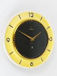 mid century modern pastel yellow junghans mid century brass wall clock germany