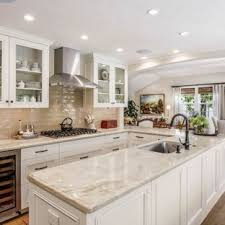 open concept kitchen mid sized traditional u shaped brown floor and um tone